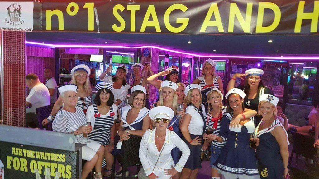 group of ladies on hen party outside of bar in Magaluf